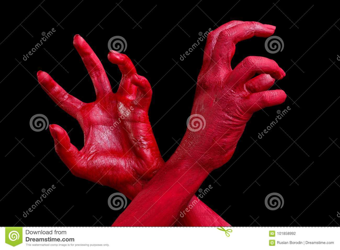human hands painted in red are posing on a black background stock