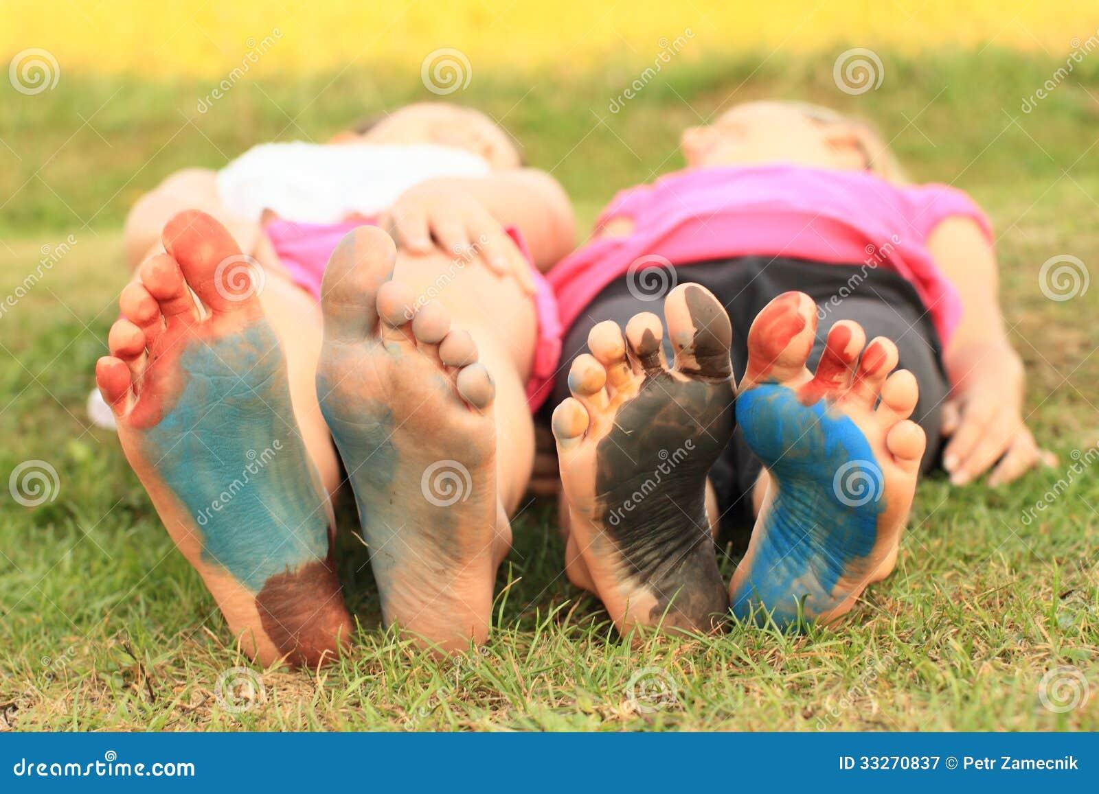 Girl Kids Feet Bare Feet of a Smiling Kids