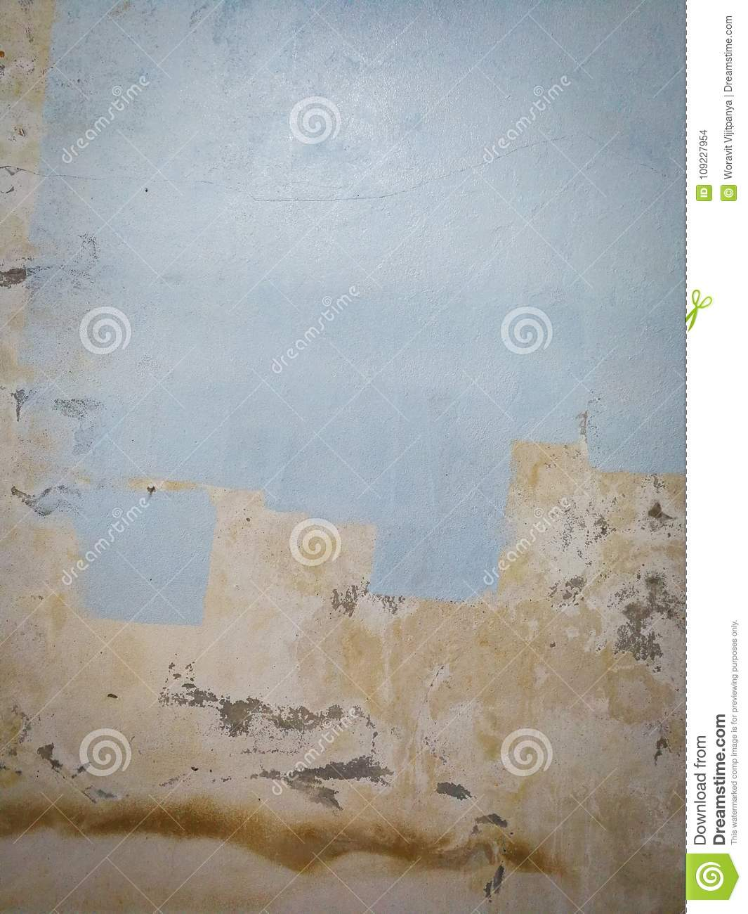 Painter worker peeling off wallpaper Abstract painted wall old wall strip