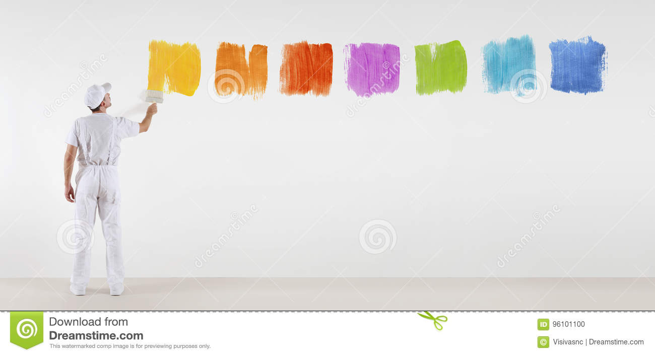 Painter man with paint brush painting color samples isolated on blank white wall background web banner menu