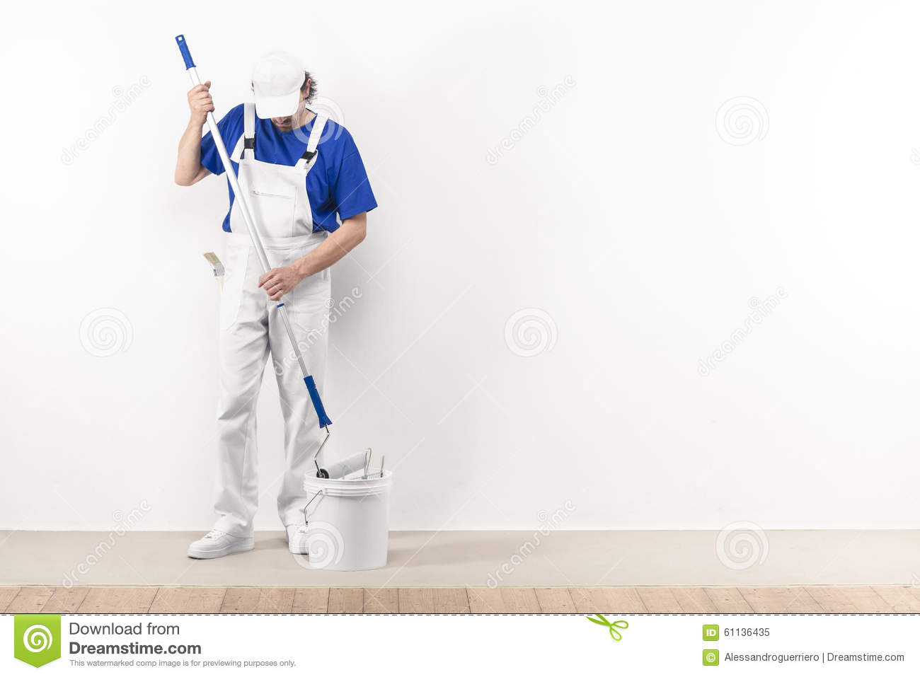 How To Redecorate Your Room Painter Man At Work Takes Color With Paint Roller From The