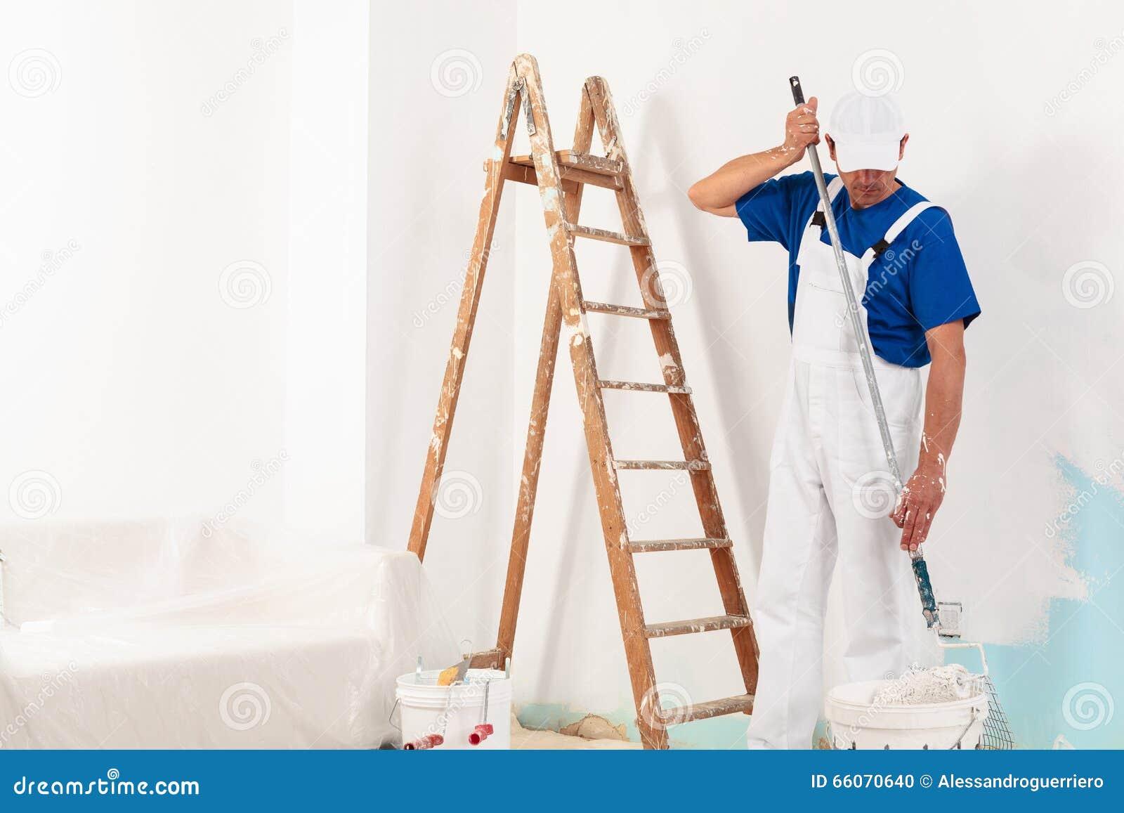 Painter man at work