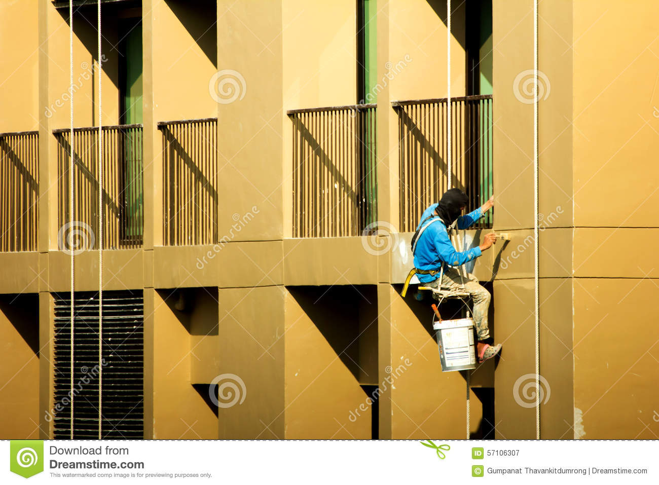 Painter painting on high rise building editorial photography image 57106307 - High build exterior paint set ...