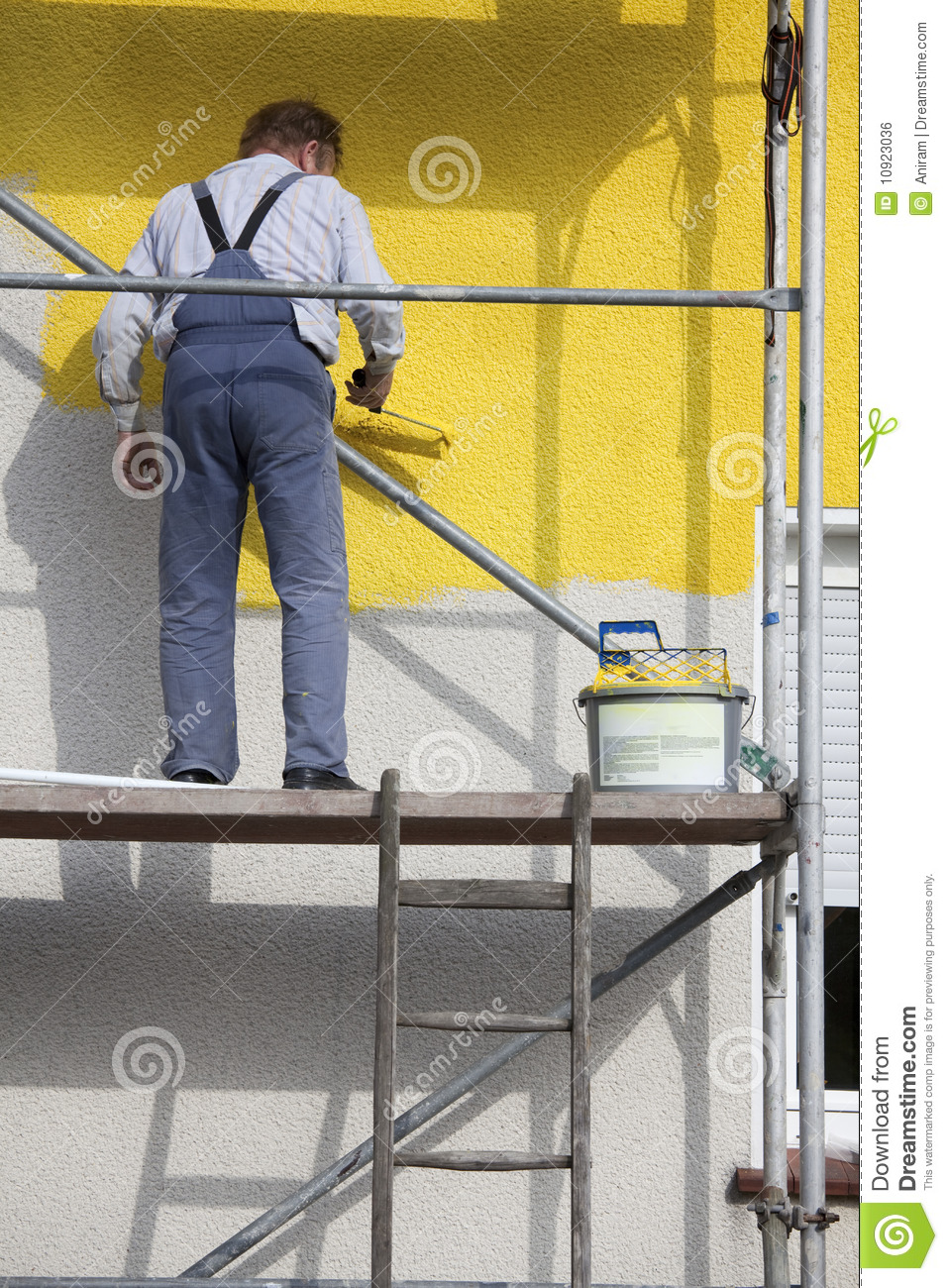 Painter On A Scaffold Royalty Free Stock Image - Image: 10923036