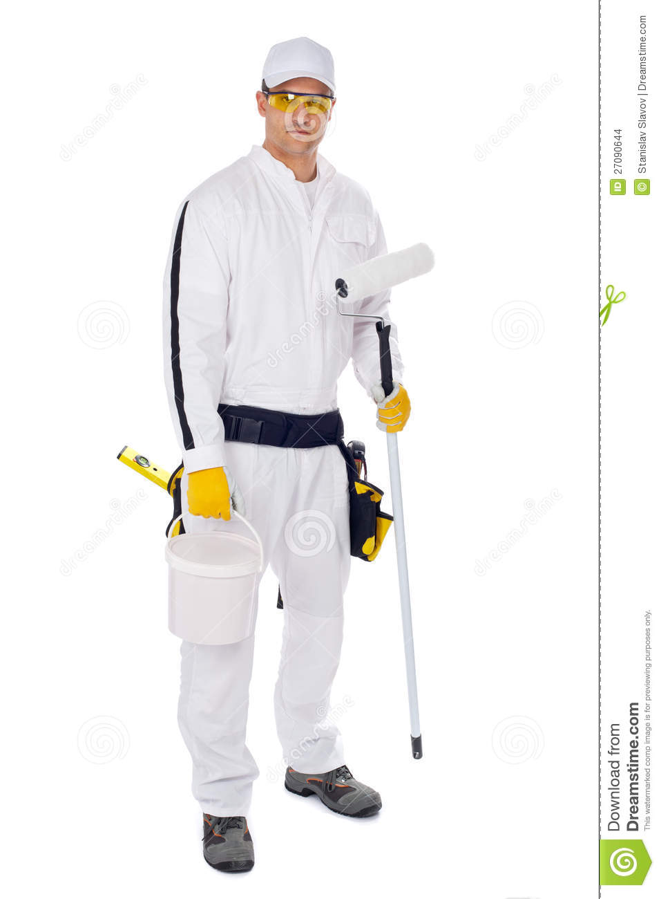 Painter in white overalls holding paint brush bucket on a white.