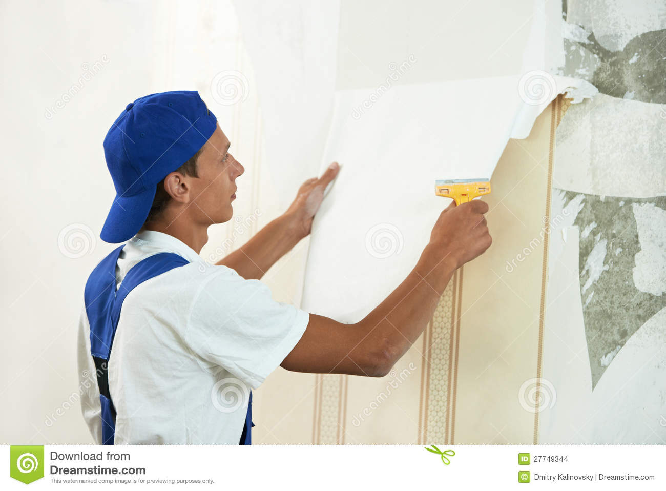 Painter And Decorator Prices >> Painter Worker Peeling Off Wallpaper Stock Photo - Image: 27749344
