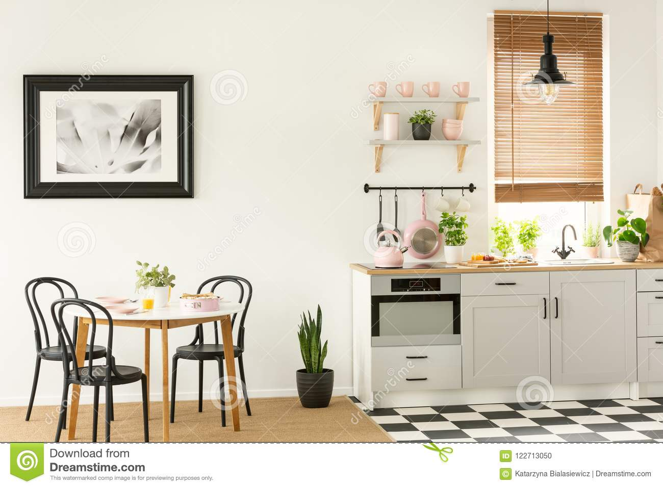 Painting In A Black Frame Dining Room Interior With Table And Chairs Next