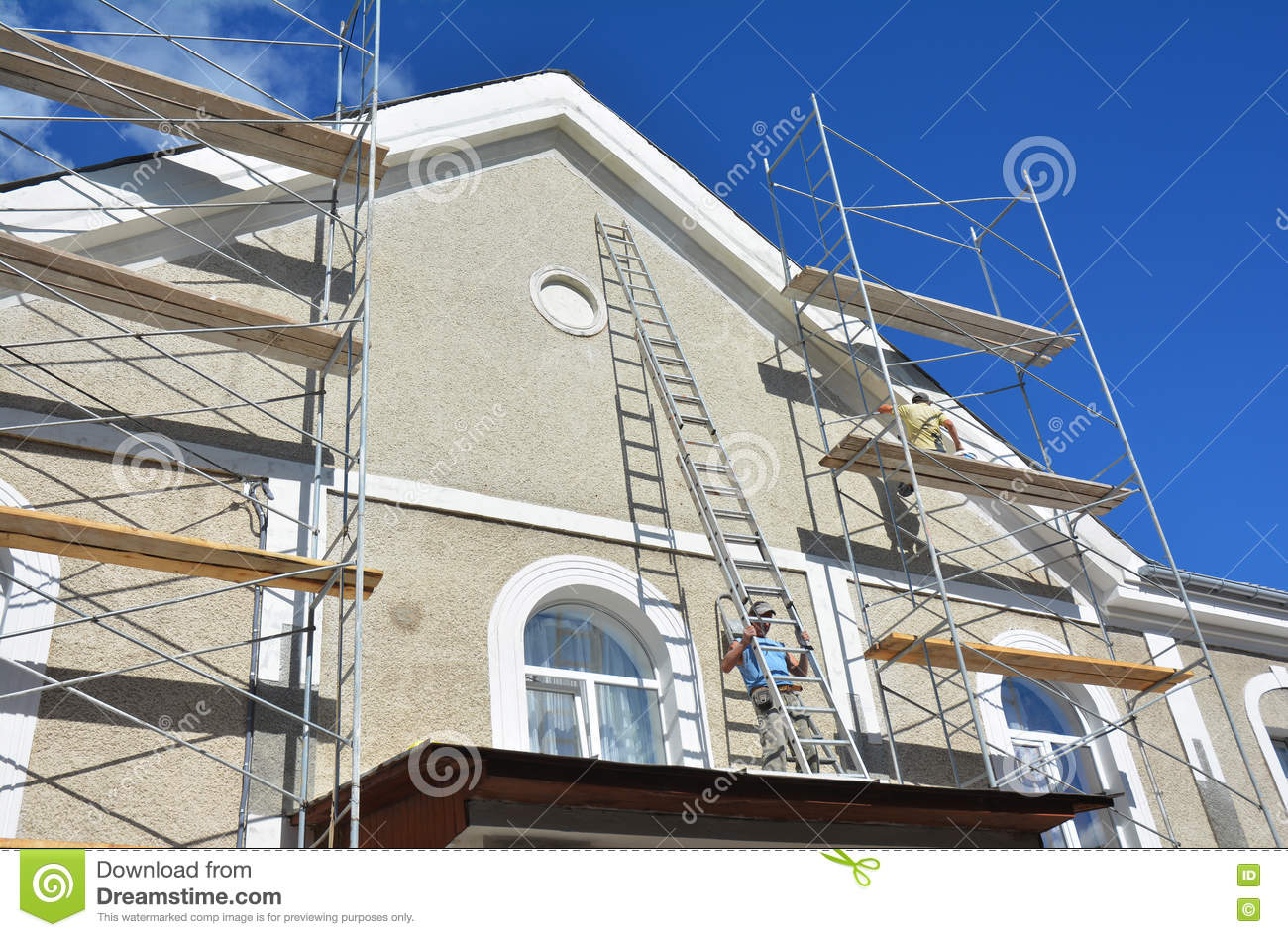 painting and plastering exterior house scaffolding wall facade thermal insulation and stucco