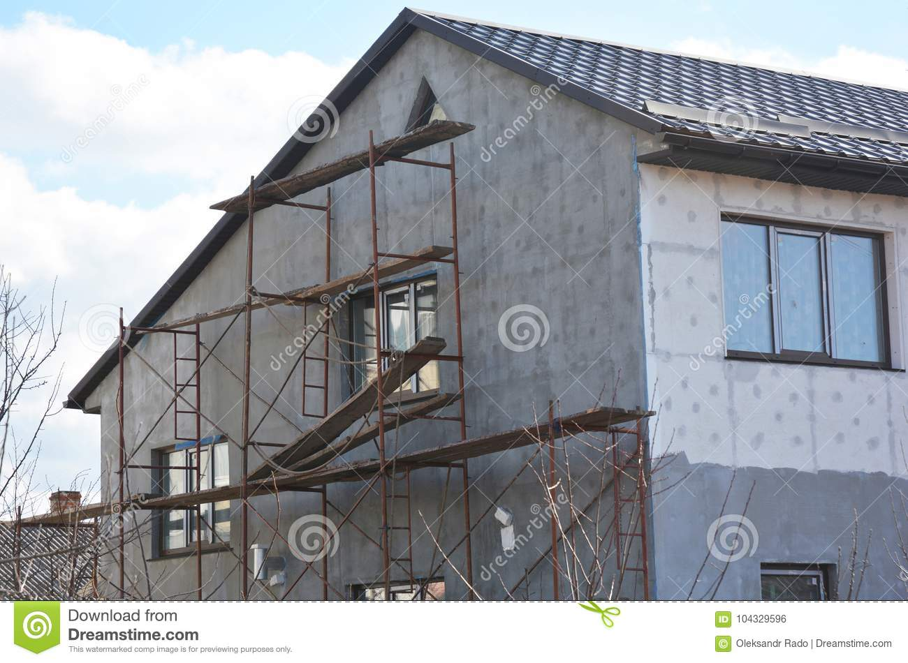 Painting Plastering Stucco And Insulate Exterior House Wall Facade Thermal Insulation And Painting Repair Works Stock Photo Image Of Home Facade 104329596