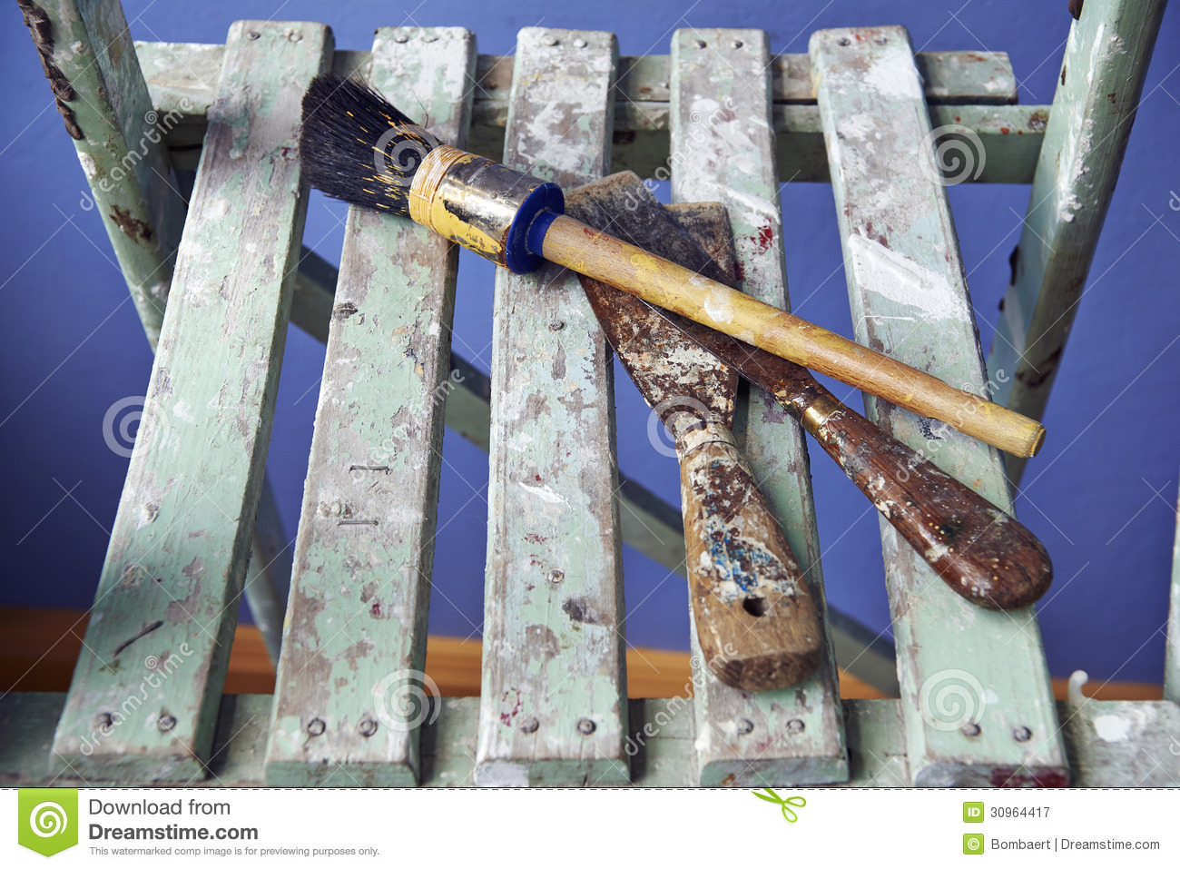 Wall Painting Equipment : Painting tools on a wooden ladder royalty free stock