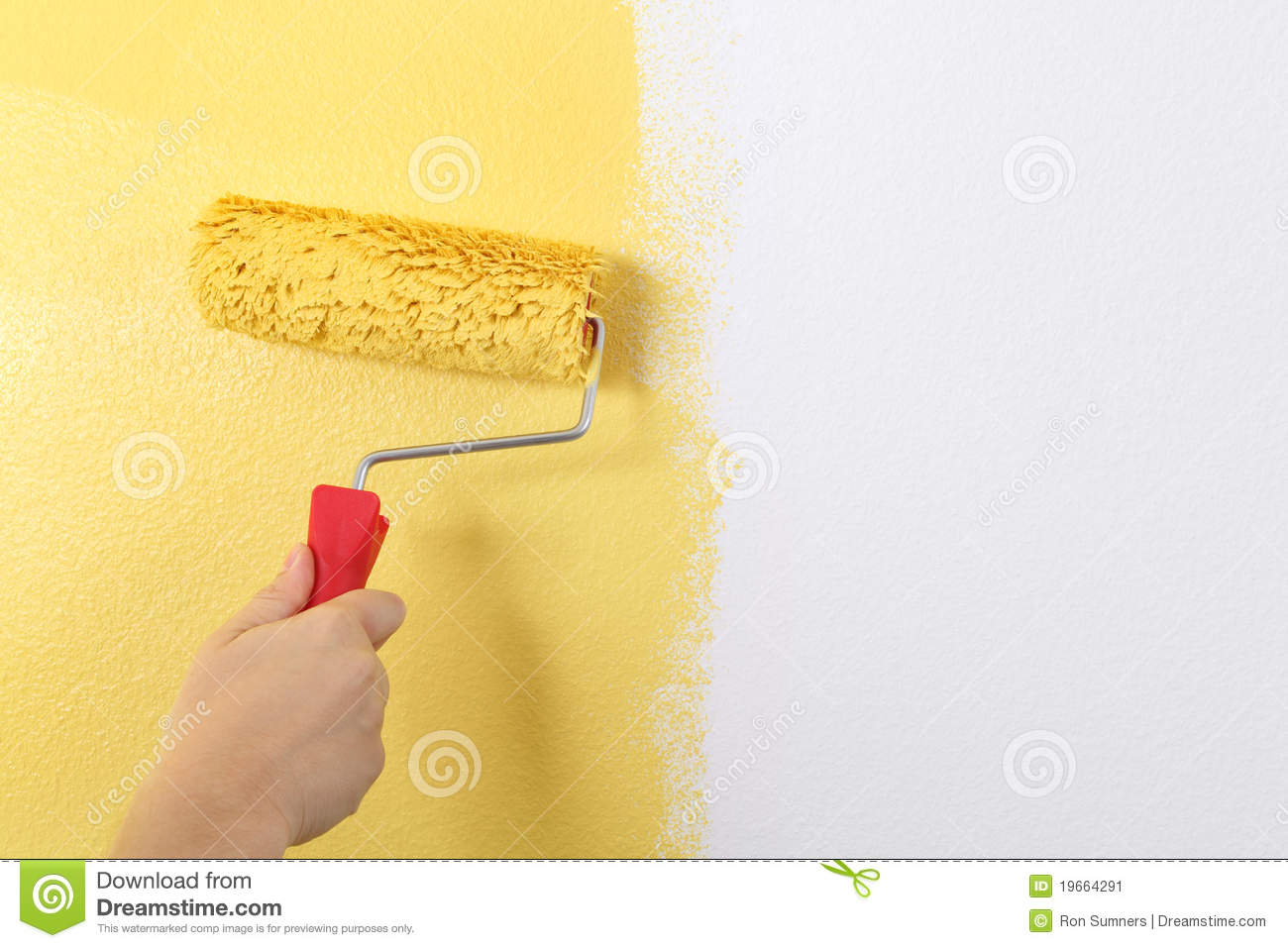 Painting The Wall With A Paint Roller Stock Image - Image of holding ...