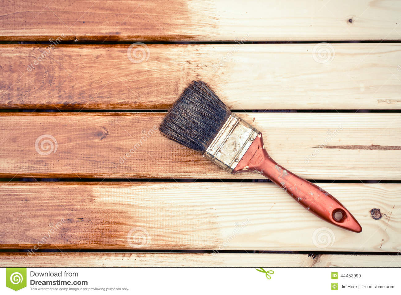 Painting A Wooden Table Using Paintbrush.. Full resolution  file, nominally Width 1300 Height 957 pixels, file with #A75D24.