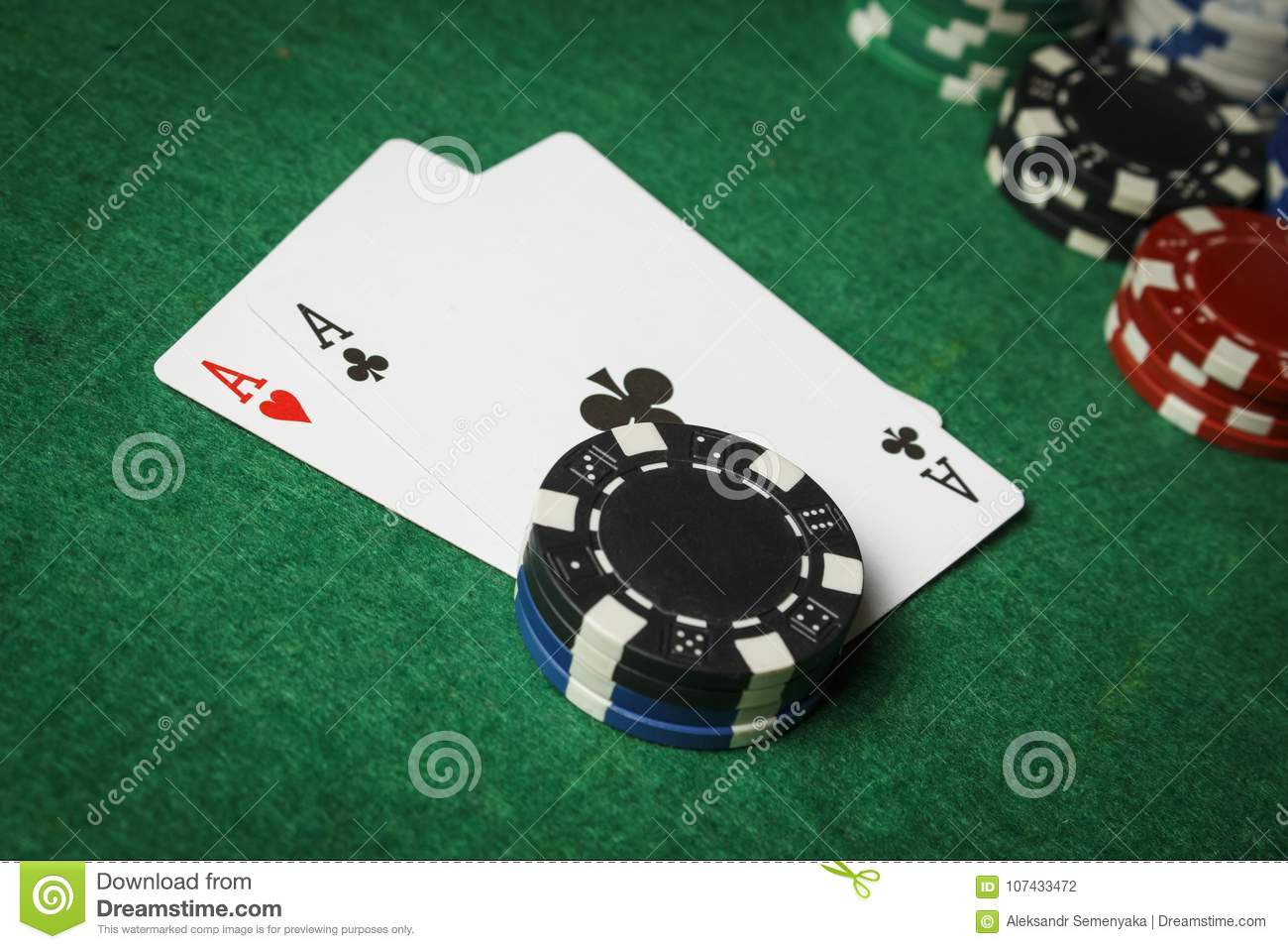 A pair of aces with a pile of poker chips