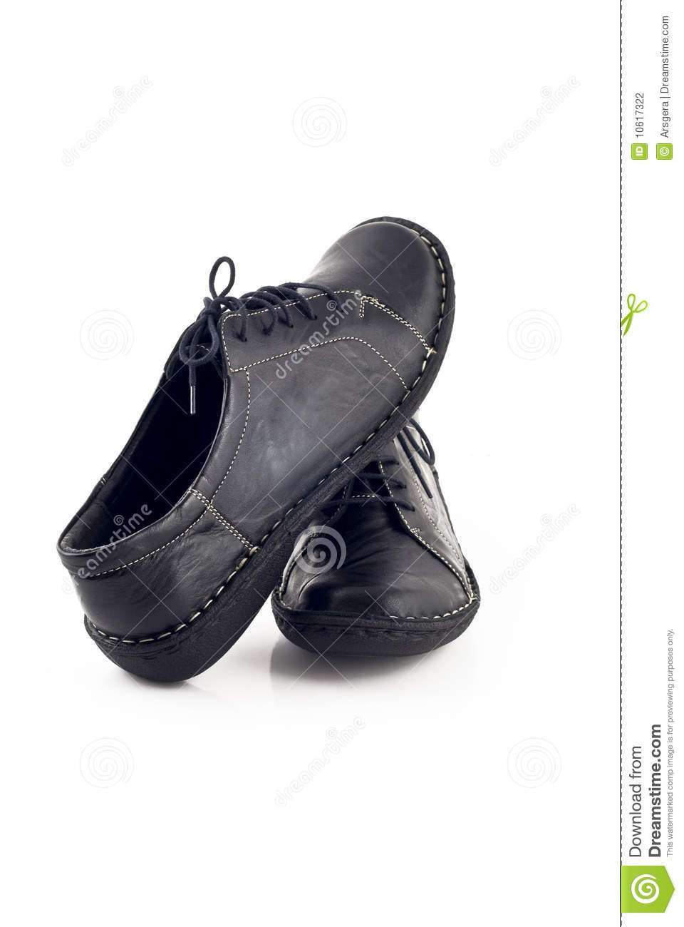 Pair Of Black Leather Shoes For Women Over White Stock Photography