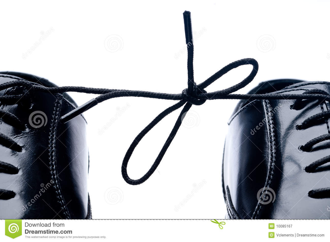 Horizontal close up of a pair of black leather business shoes with