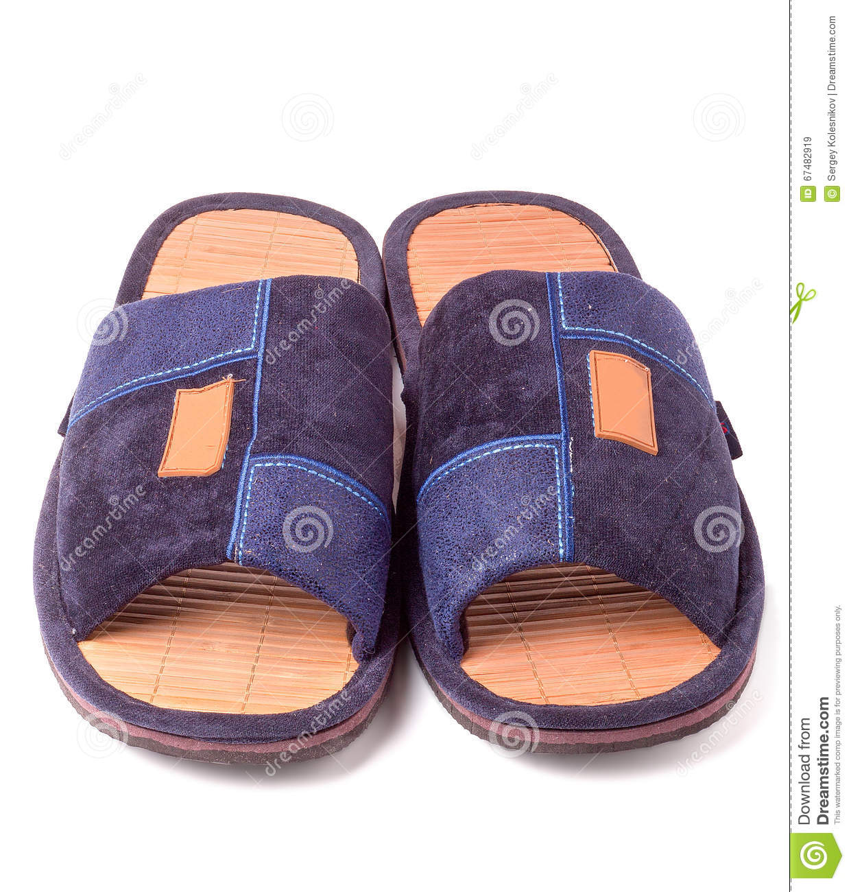 Pair of blue textile slippers on white background closeup