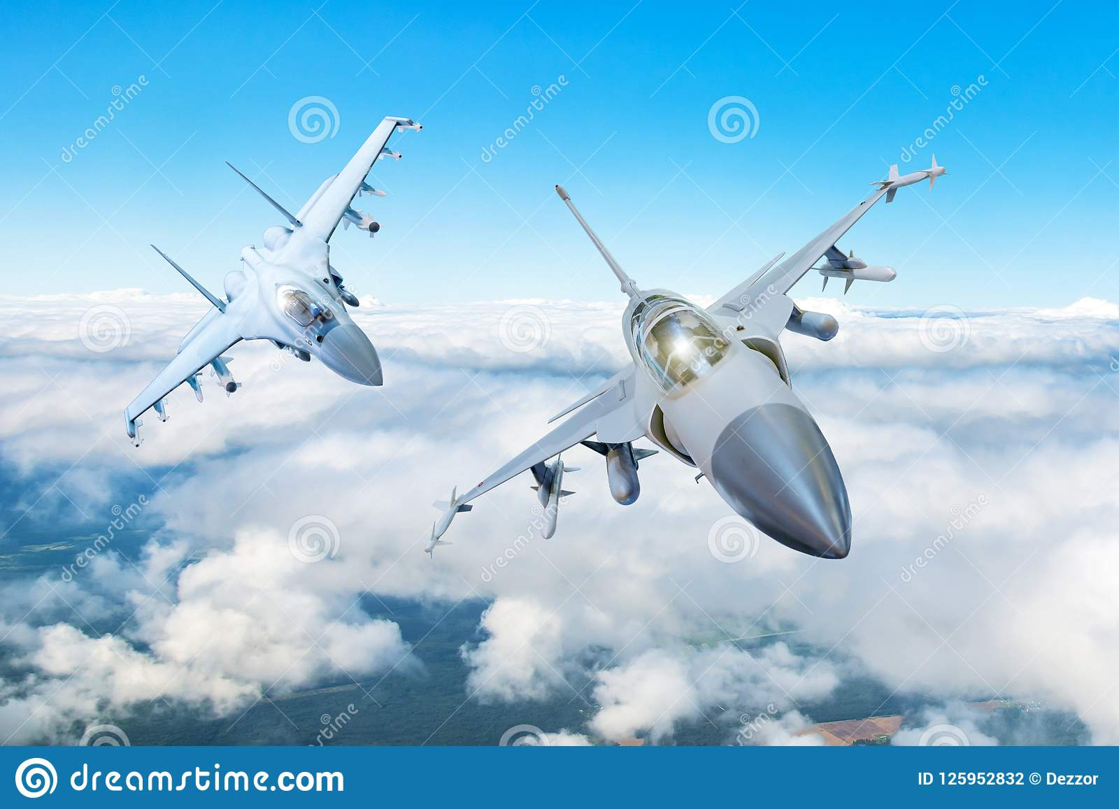 Pair of combat fighter jet on a military mission with weapons - rockets, bombs, weapons on wings flies high in the sky above the c