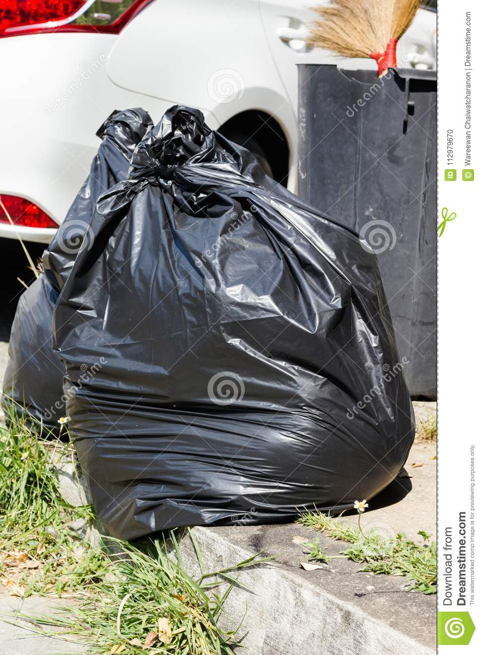 Pair or couple big black trash or garbage bag