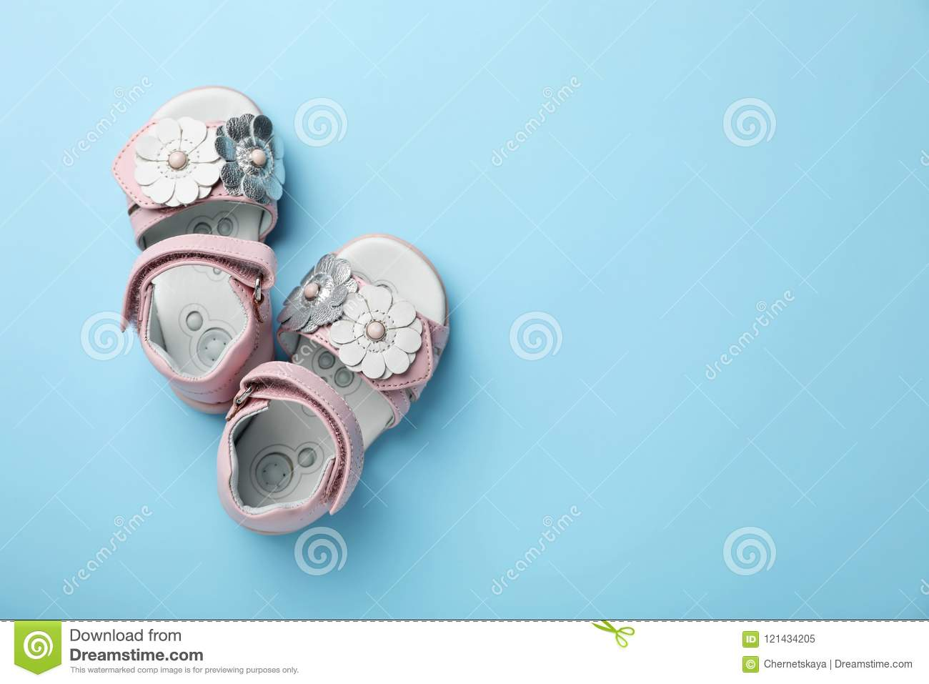 e6bba187c66f63 Pair Of Cute Baby Sandals On Color Background Stock Image - Image of ...