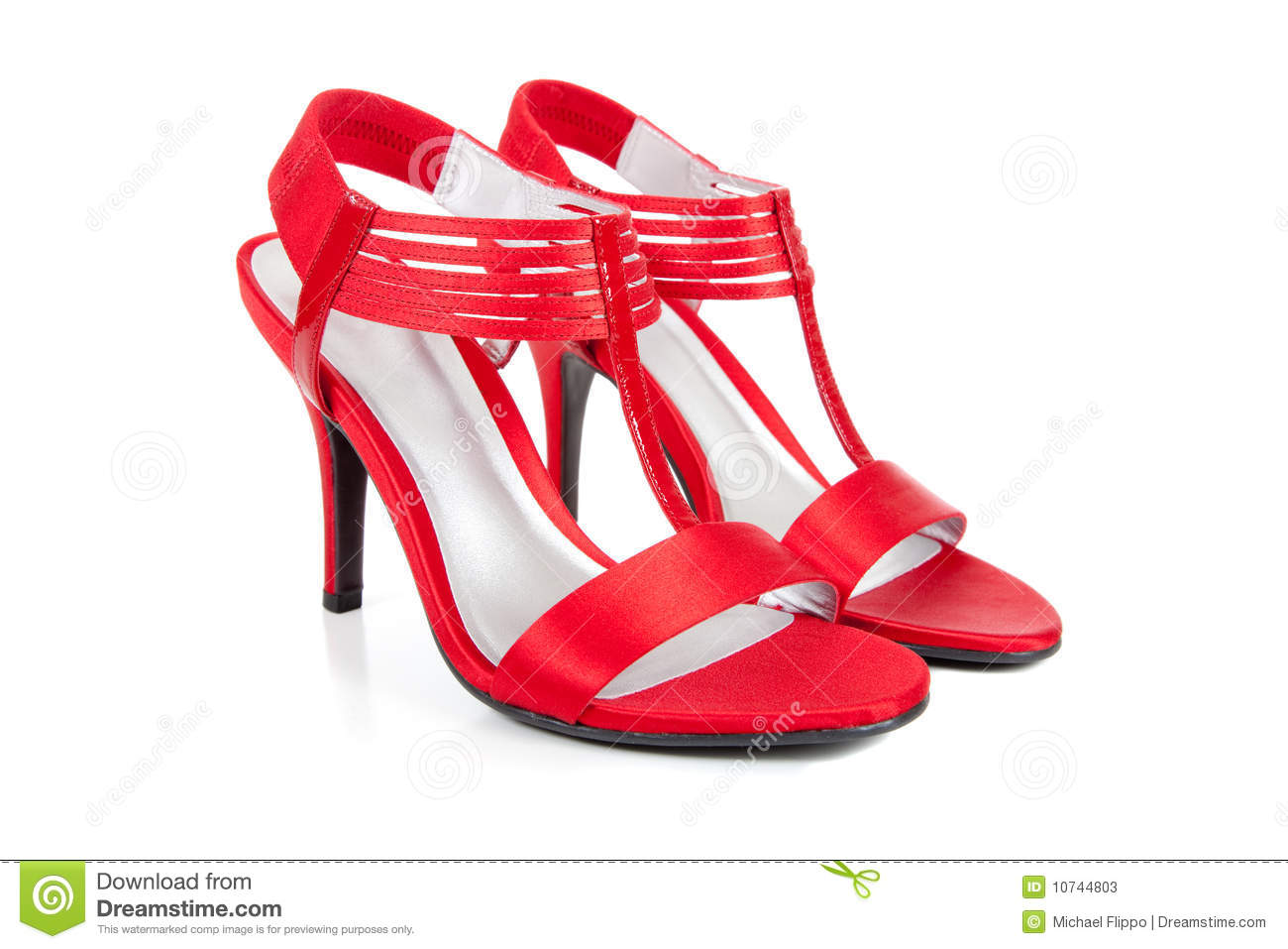 pair of sexy, elegant, high heel, red ladies dress shoes on a white ...