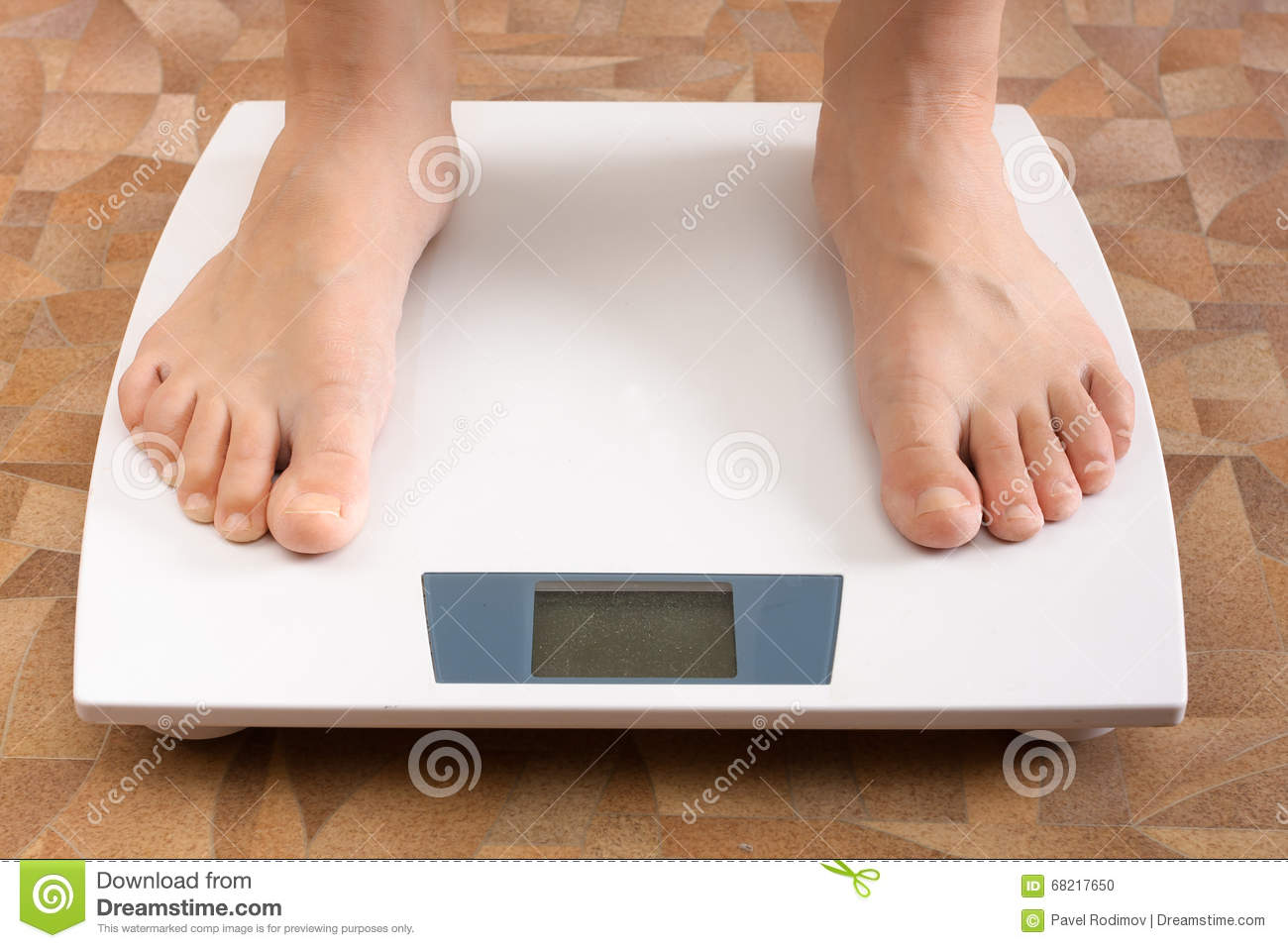 Pair feet standing on the scale
