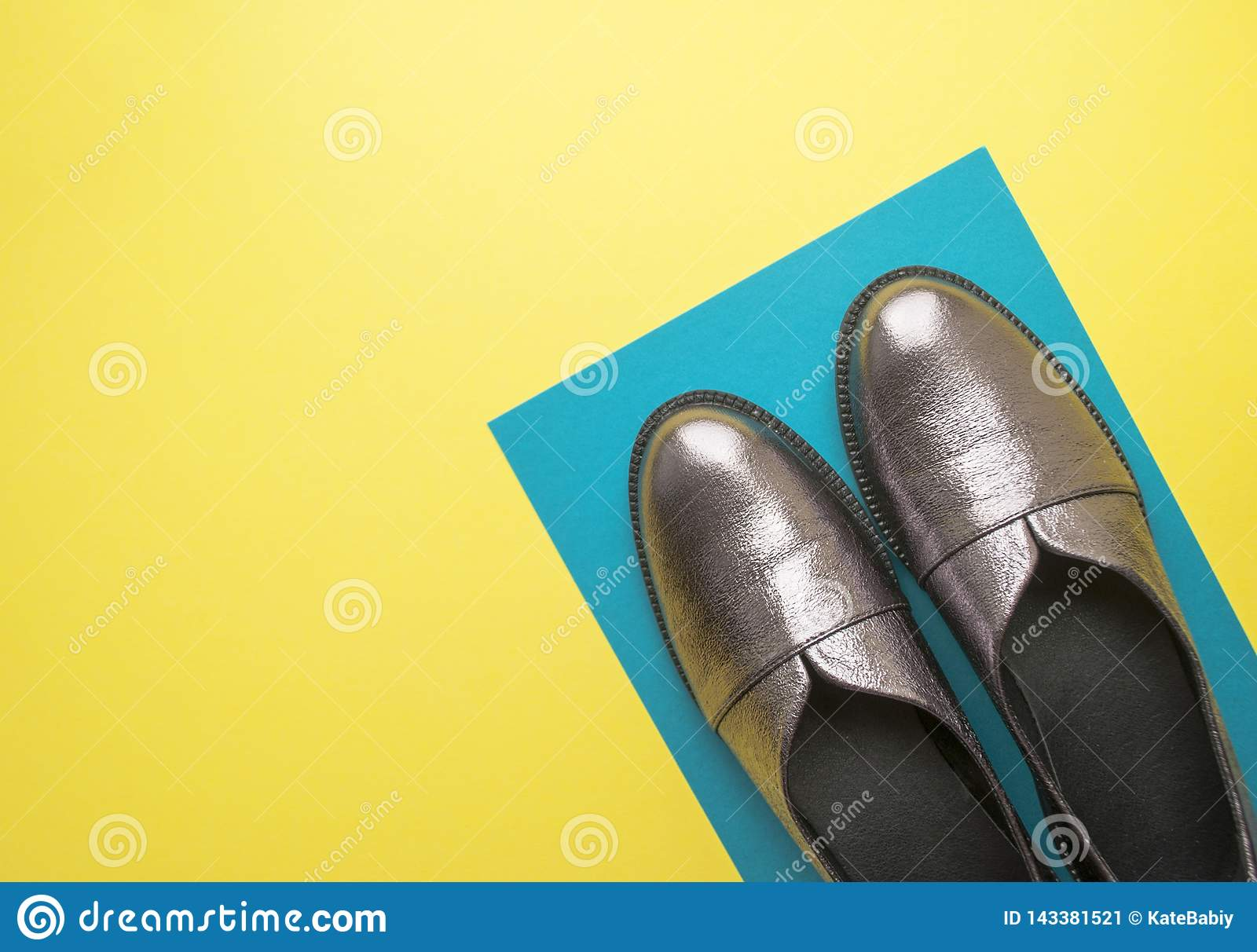Pair of female shoes on yellow background