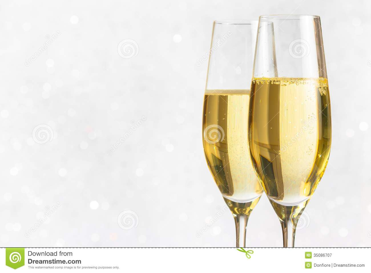 A Pair Of Flutes Of Golden Champagne On Silver Bokeh Stock ...