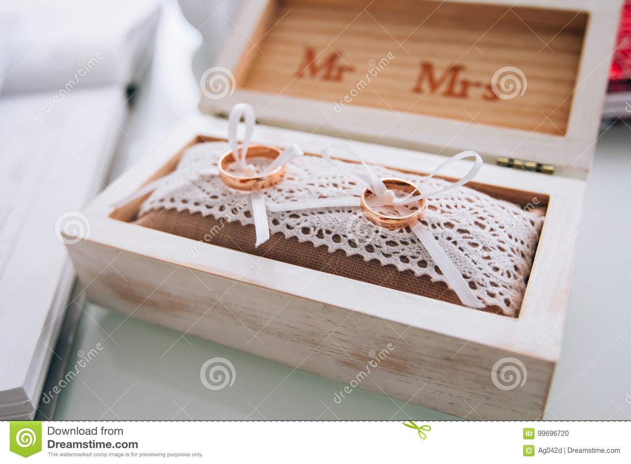 A Pair Of Golden Wedding Rings Lying In A White Wooden Box Wedding