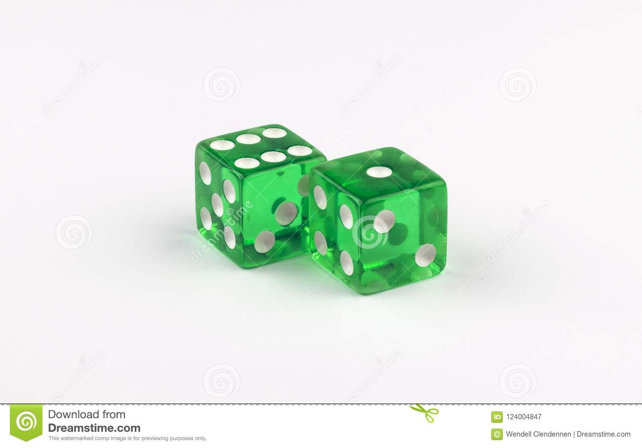 A pair of green, translucent gaming dice showing seven spots