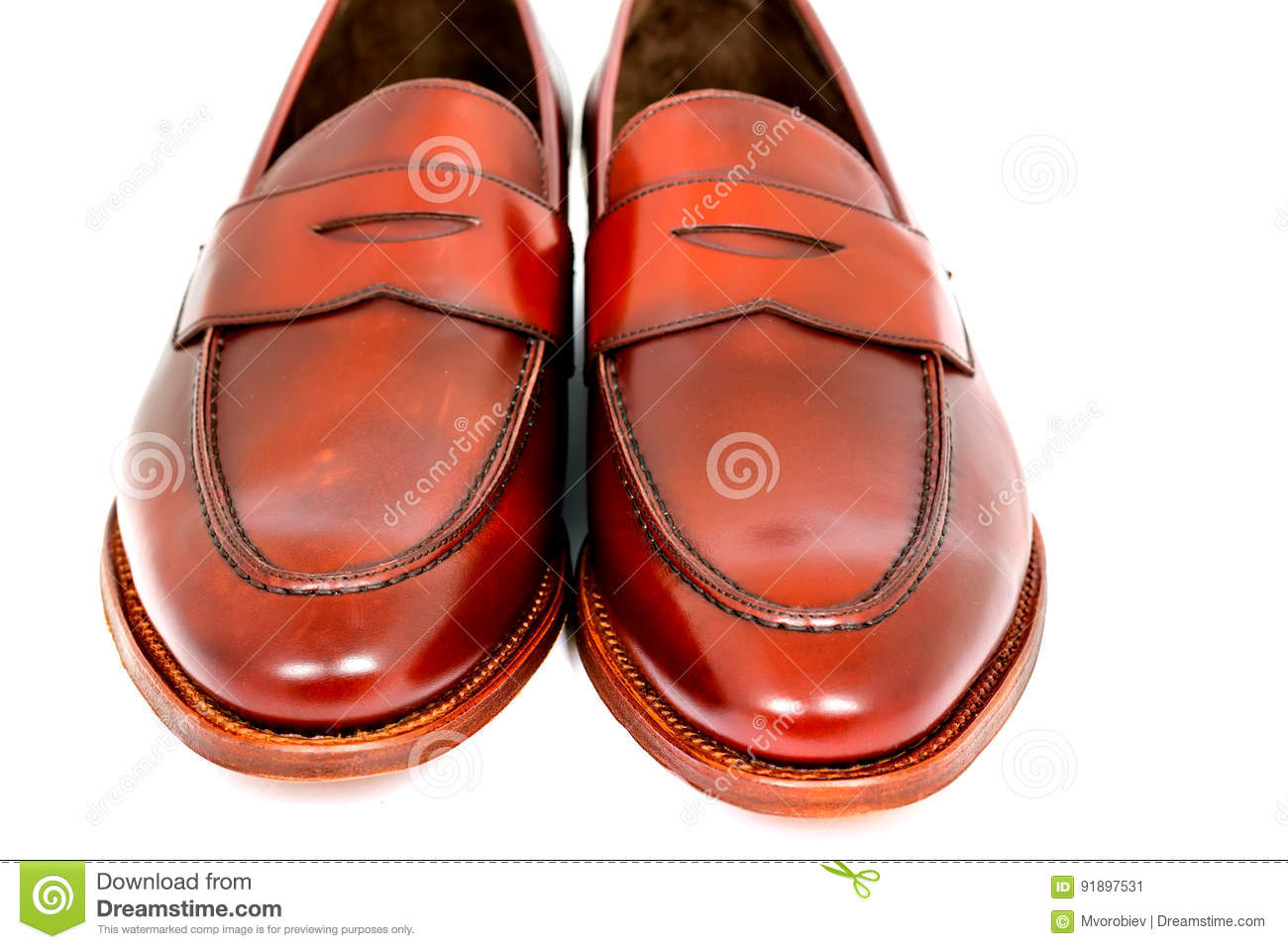 4c7ab39edaf Pair of leather burgundy penny loafer shoes together on white background.  Horizontal image