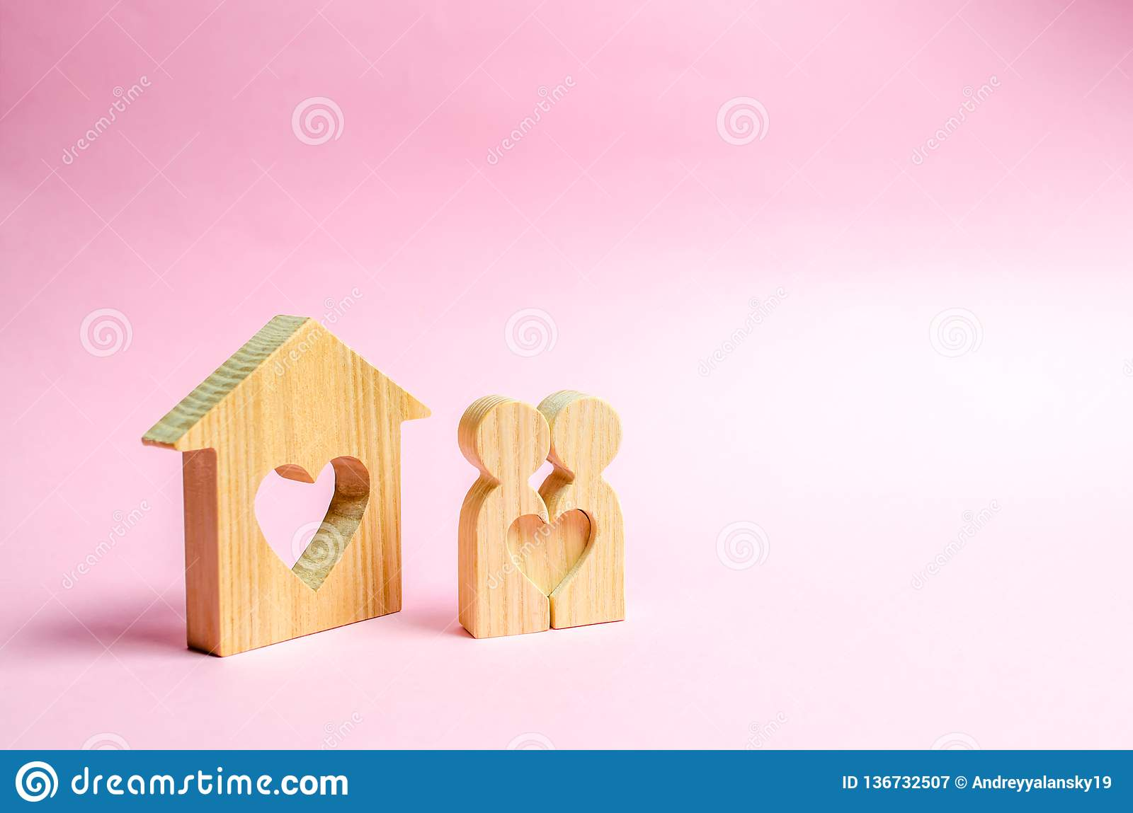 Pair of lovers stand near people at home with a heart. Happy family near the new home. The concept of finding a love nest
