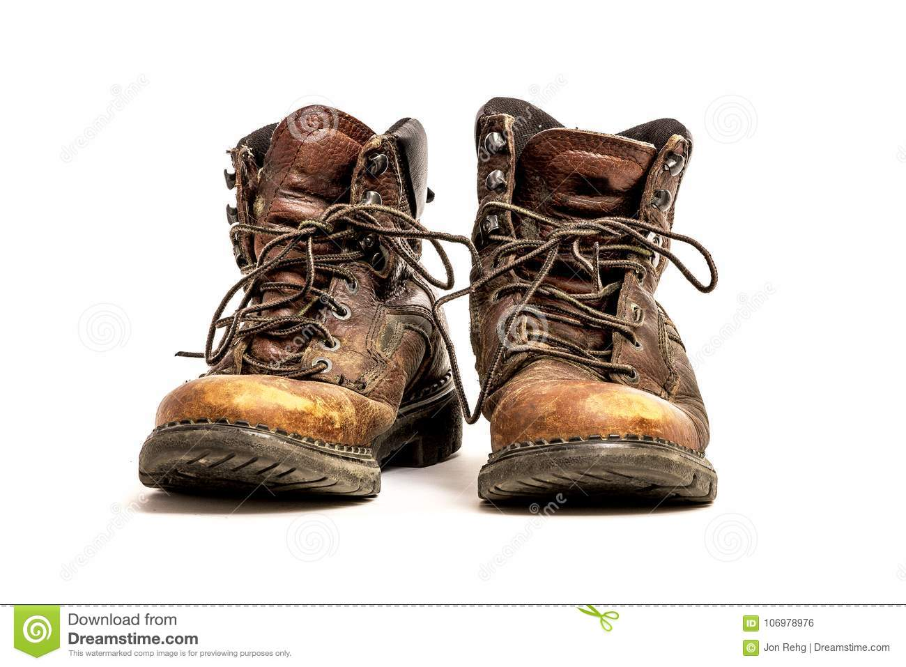 Pair of Men`s Dirty Beat Up Grungy Brown Leather Work Boots Isolated on White Background