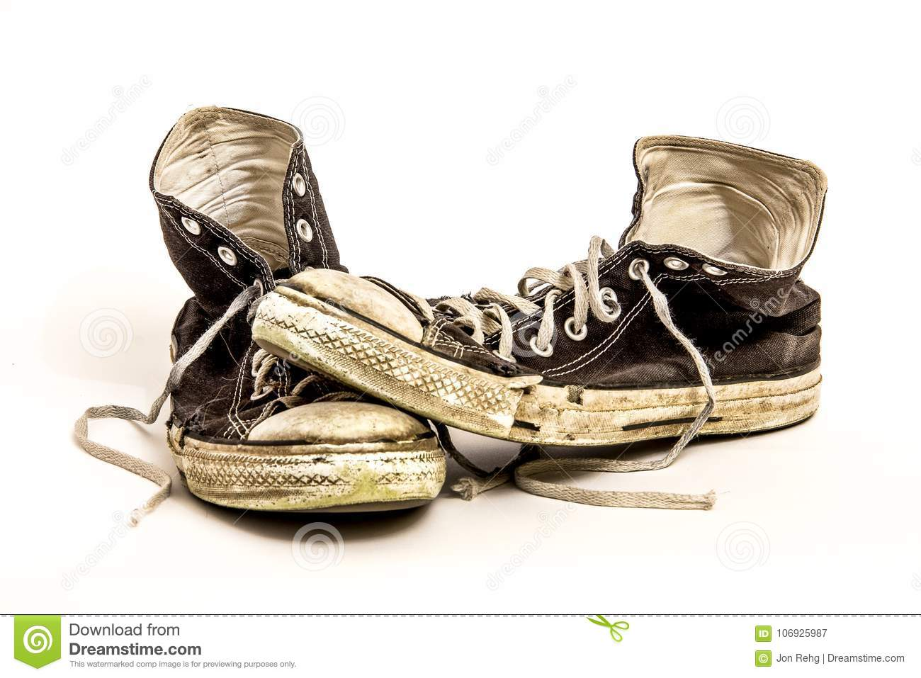 9e81e6834460 Pair of Men`s or Teenager`s Worn Out Dirty High Top Athletic Tennis Shoes  with Long Laces on White Background