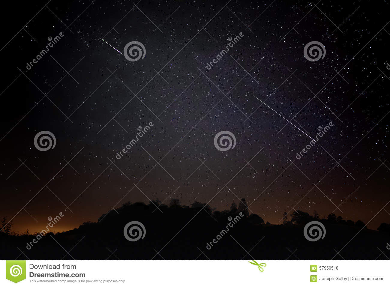 Pair of Meteors. Meteor Shower Night Sky with Landscape Silhouette