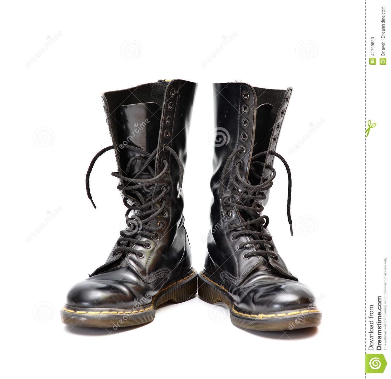 Pair Of Mid calf 14 Eyelet Black Lace up Boots Stock Photo
