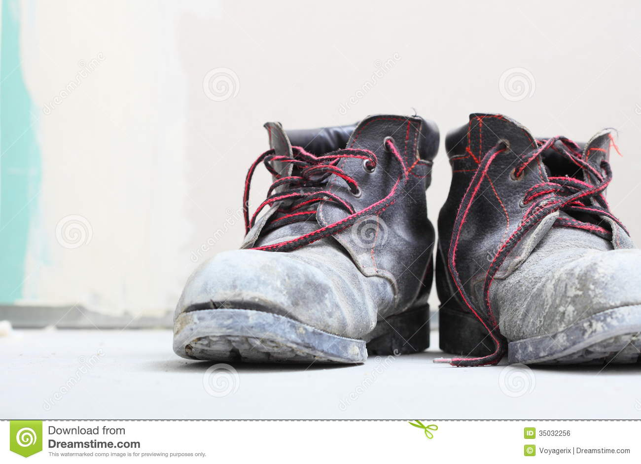 Pair Of Old Dirty Work Boots In Building Site Royalty Free