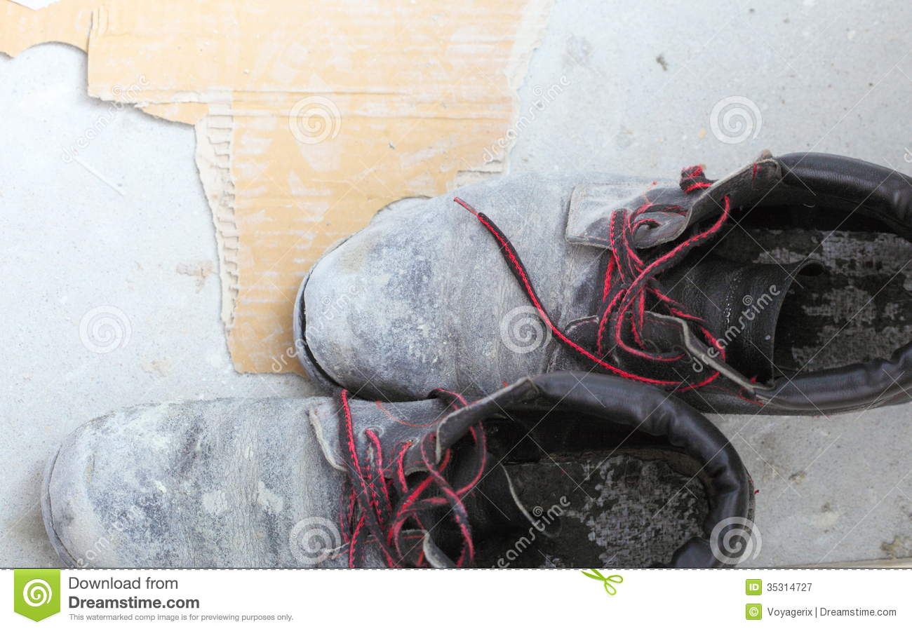 Free Stock Photography: Pair of old dirty work boots in building site