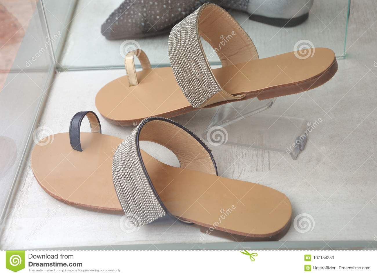 A Pair Of Open Toe Sandals With Big Toe