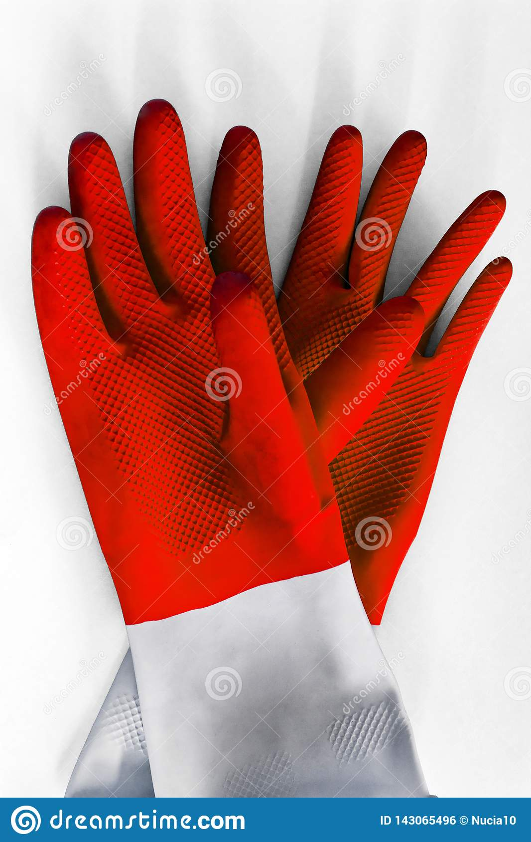 Pair Red rubber gloves for cleaning on white background, with shadow, top view. housework concept. General or regular cleanup.