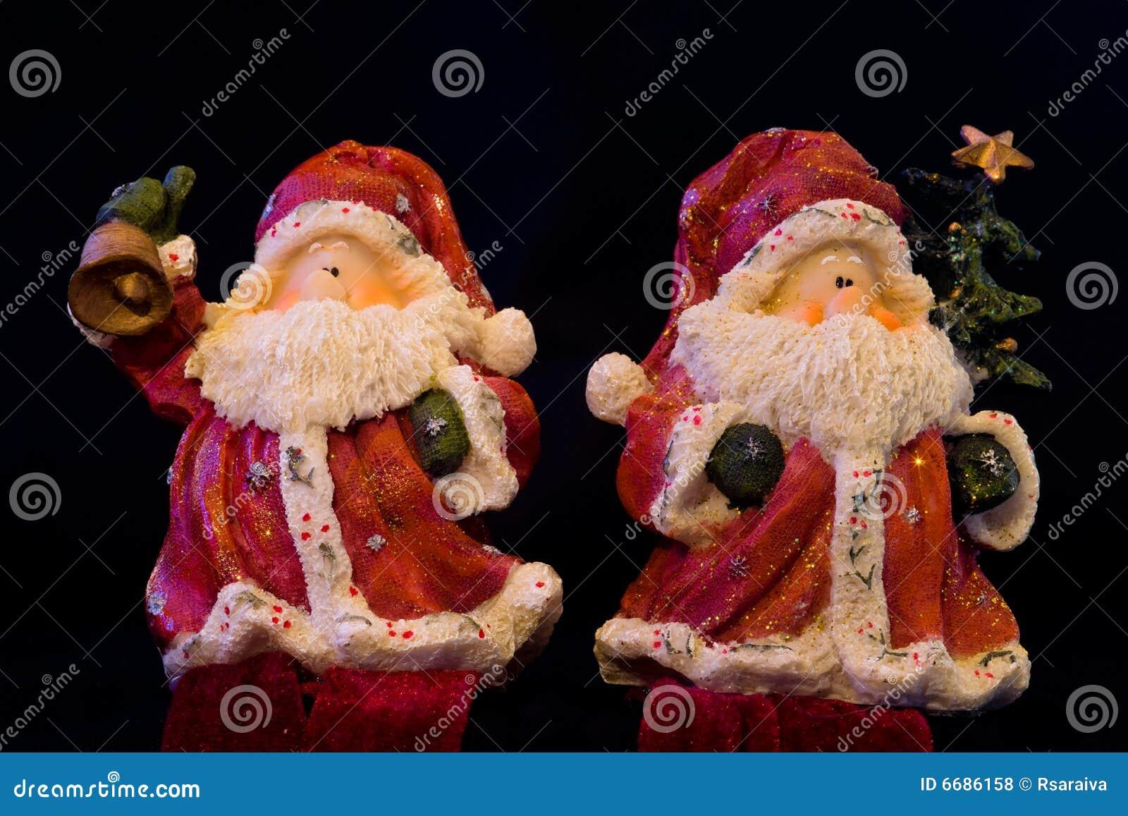Pair of santa figurines stock photo image of figurine