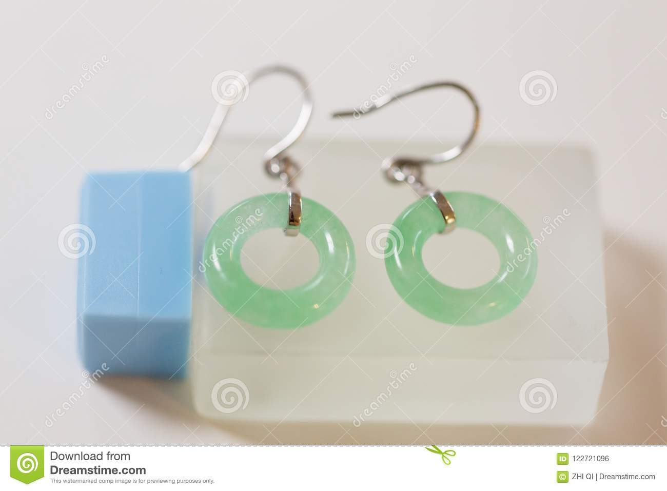 Pair of silver earring with circle jade closeup