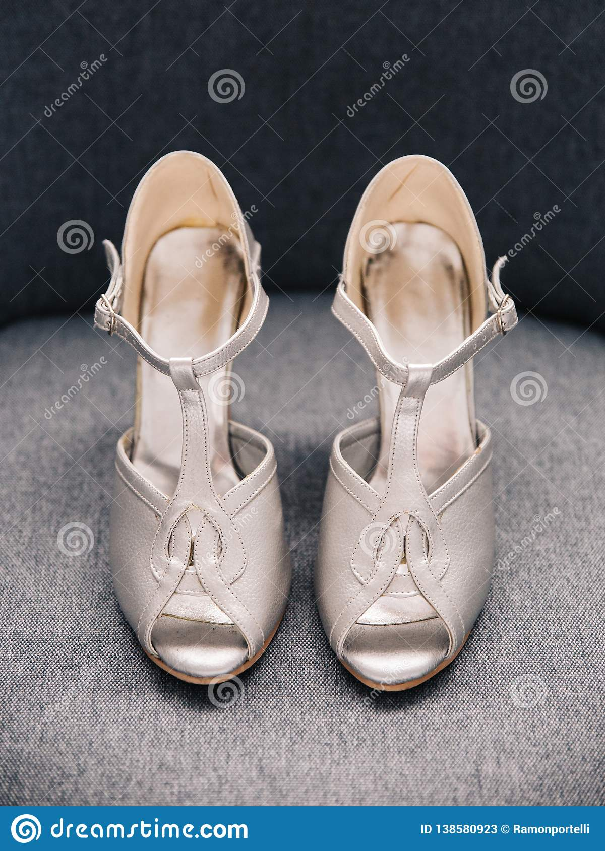 Pair of silver female high heeled wedding shoes