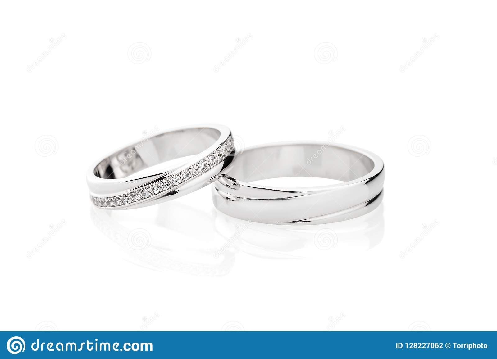 Pair Of Silver Wedding Rings With Diamonds Isolated On White