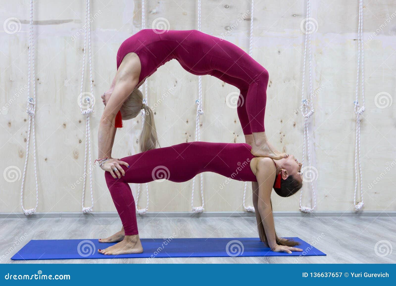 Pair Sporty Yoga Women Doing Exercise On Gray Stylish Background