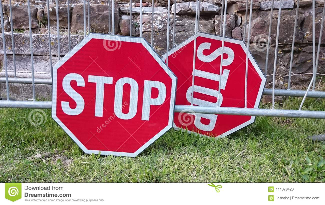 A pair of stop signs
