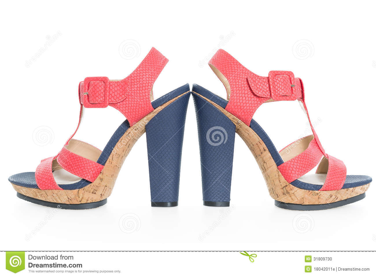 pair of trendy navy blue and pink shoes on white stock