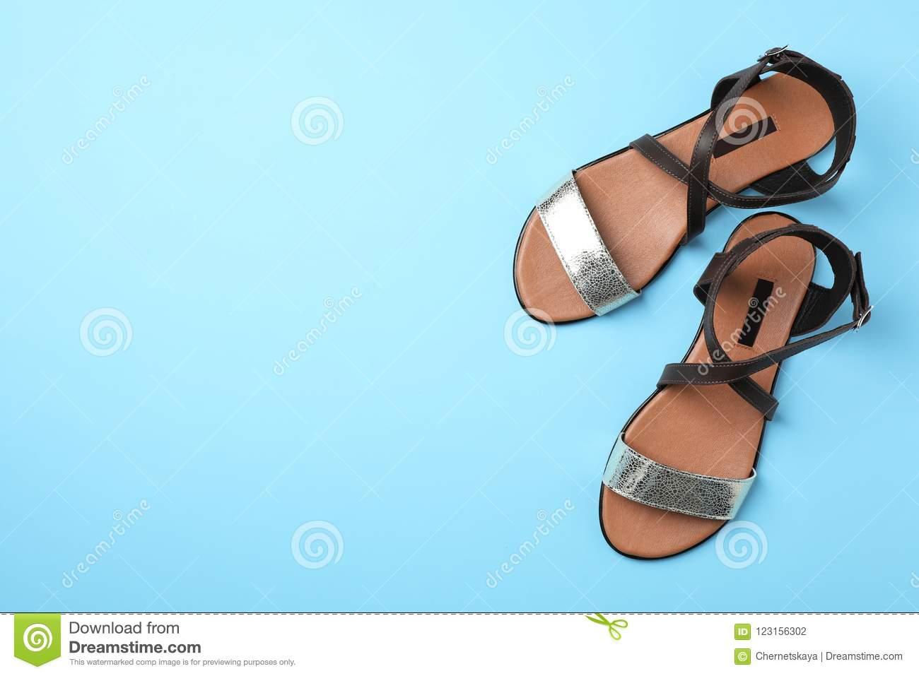 Pair of trendy women`s shoes color background, top view