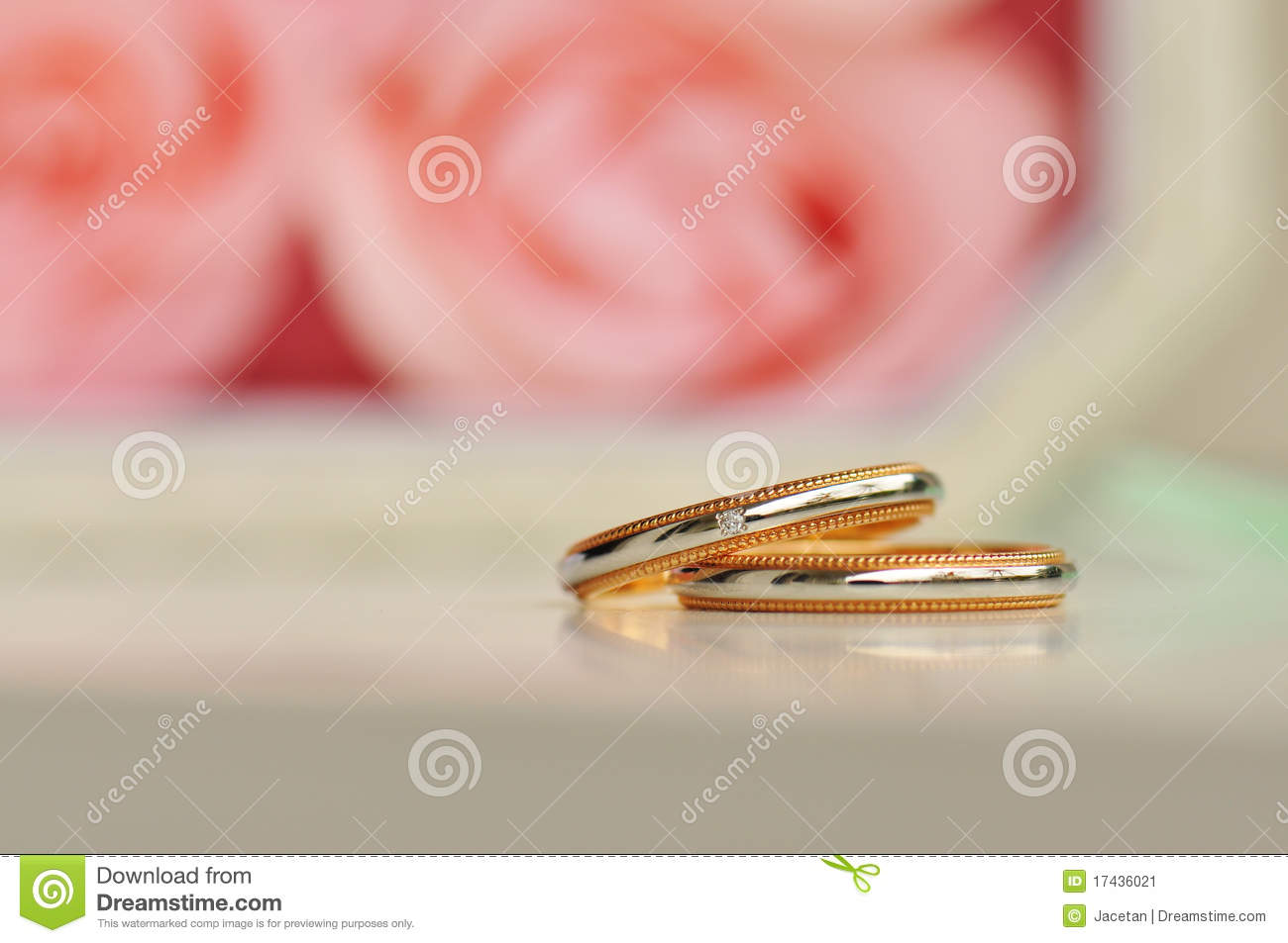 Pair Of Wedding Ring Roses In The Background Stock Image ...