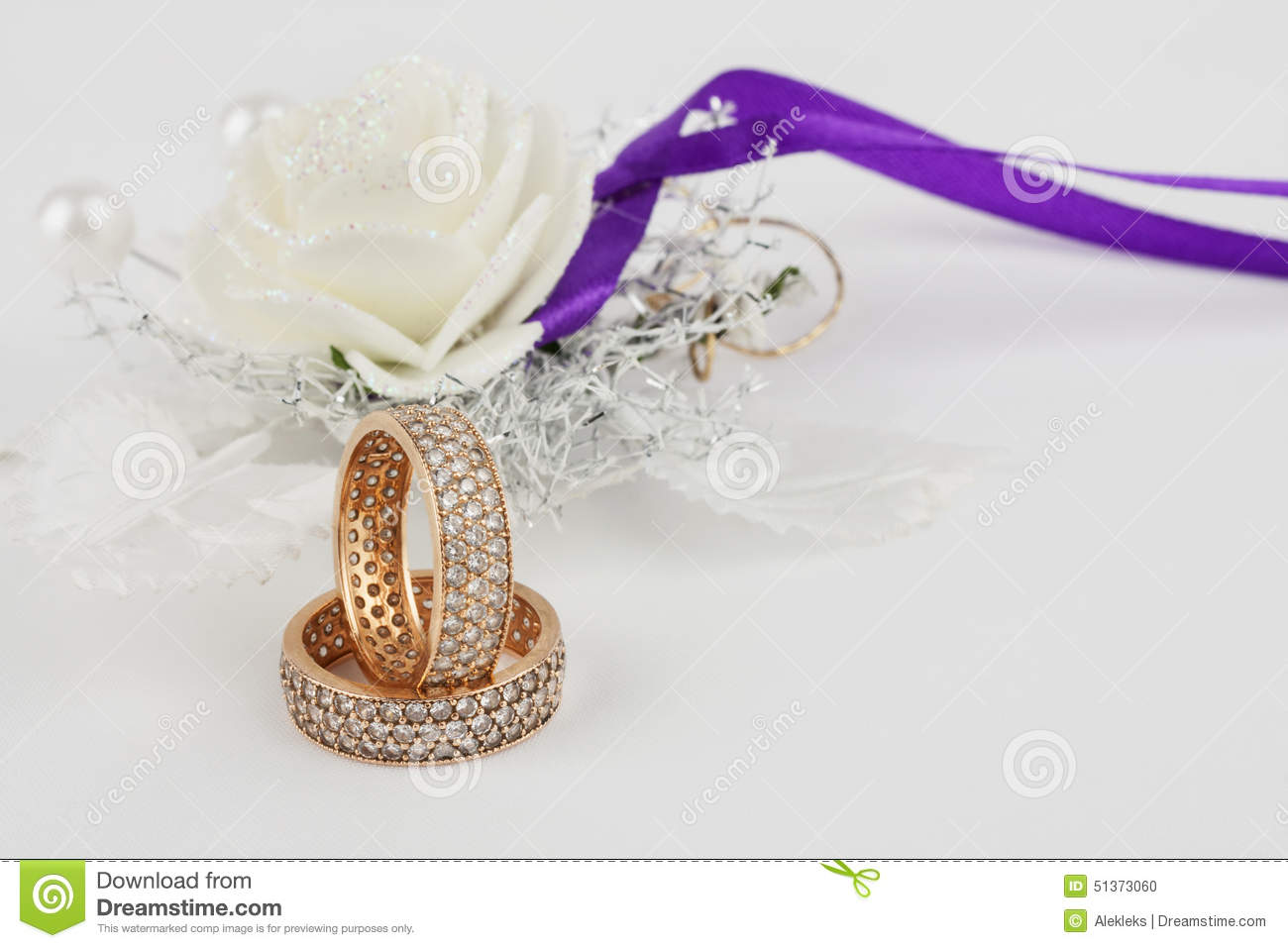 A Pair Of Wedding Rings On Wedding Background Stock Photo Image of