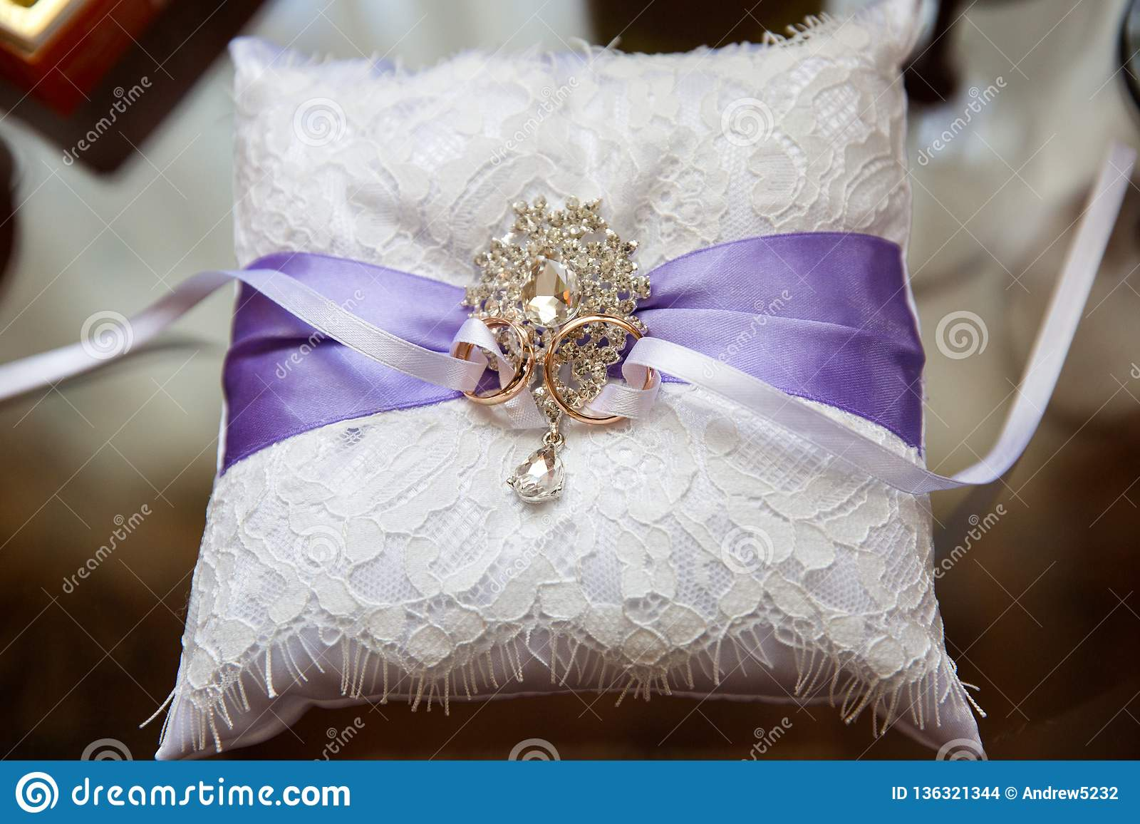 A Pair Of Wedding Rings On A White Pillow Stock Photo Image Of